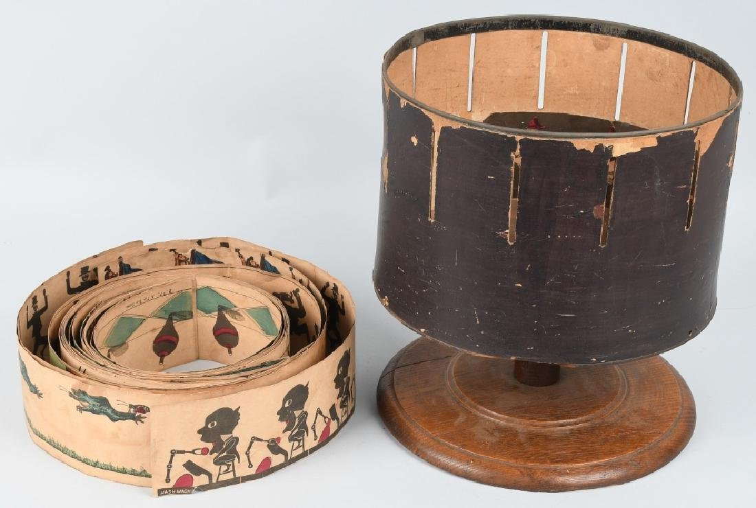 EARLY WOODEN ZOETROPE WITH STRIPS