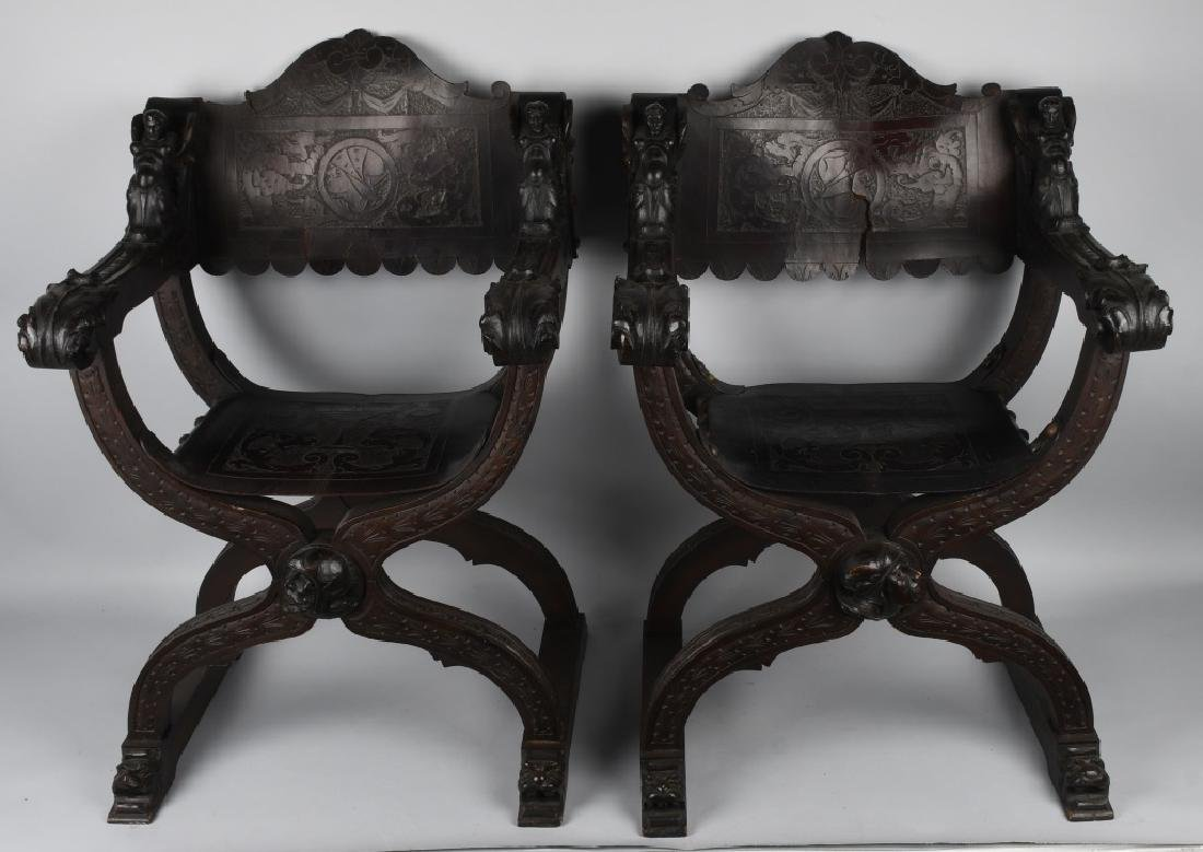 MATCHED PAIR CARVED FOLDING SAVONAROLA CHAIRS