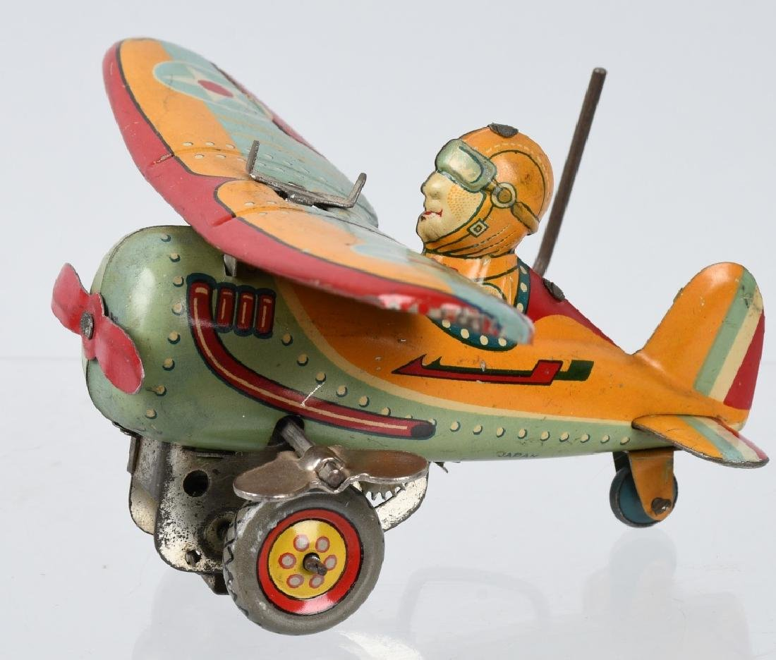 JAPAN 1930's TIN windup ROLLOVER AIRPLANE