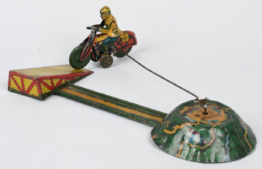 GERMAN WINDUP MOTORCYCLE GO-ROUND