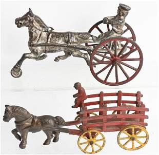 2- CAST IRON HORSE DRAWN WAGONS