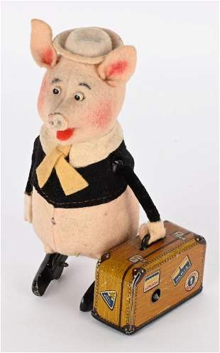 SCHUCO WINDUP WALT DISNEY PIG & SUITCASE