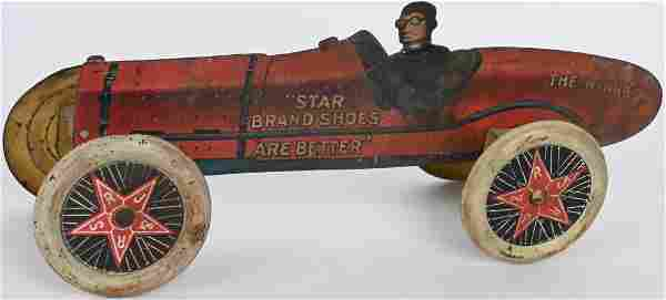 ANTIQUE STAR SHOES TIN ADVERTISING RACE CAR