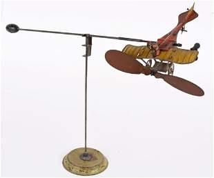 GERMAN TIN WINDUP FLYING BLERIOT AIRPLANE