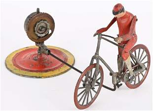 FRENCH WINDUP BICYCLE GO-ROUND