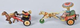 Two Tin Horse Trotting Toys