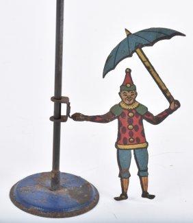 Early Tin Clown W/ Umbrella Gravity Toy