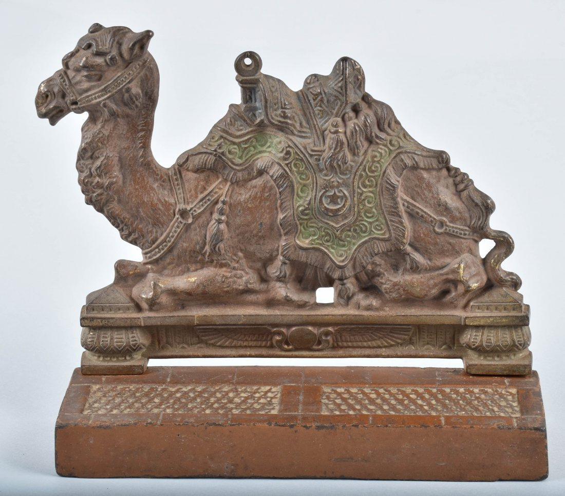 2-CAST IRON DOORSTOPS, CAMEL & BASKET OF FLOWERS - 2