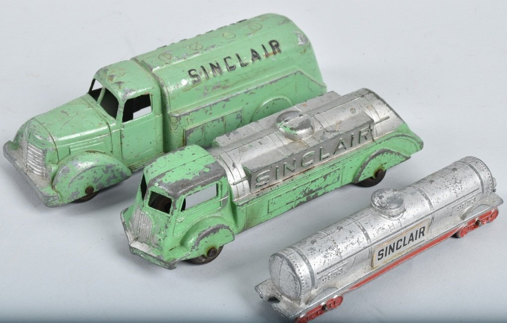 Lot of 4- SINCLAIR TOY TRUCKS & DINO