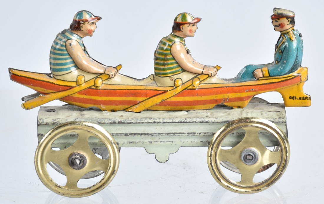 GERMAN PENNY TOY MEN IN ROW BOAT