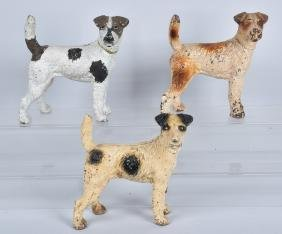 3- FOX TERRIER CAST IRON DOORSTOPS