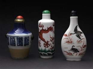 Three porcelain snuff bottles