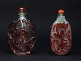 Two glass overlay decorated snuff bottles.