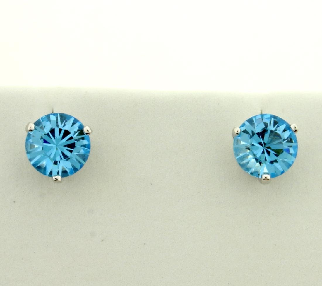 1 1/2ct TW Blue Topaz Earrings in 14K Yellow and White