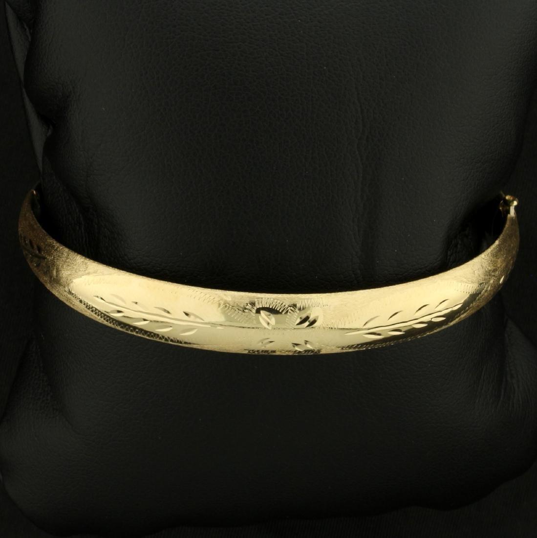 Diamond Cut Floral Design Bangle Bracelet in 14K Yellow
