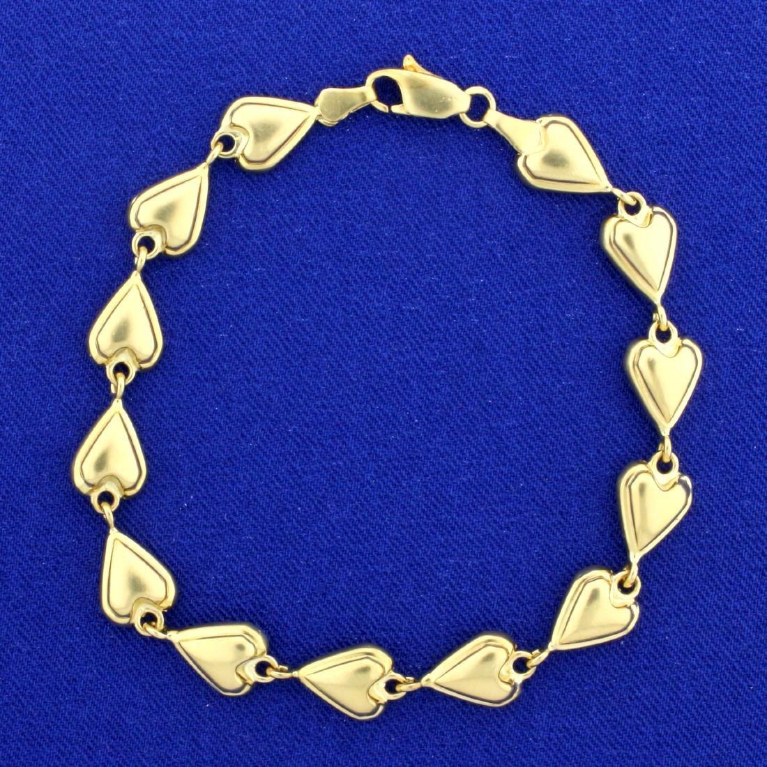 7 1/2 Inch Heart Link Heart Bracelet in 14K Yellow Gold
