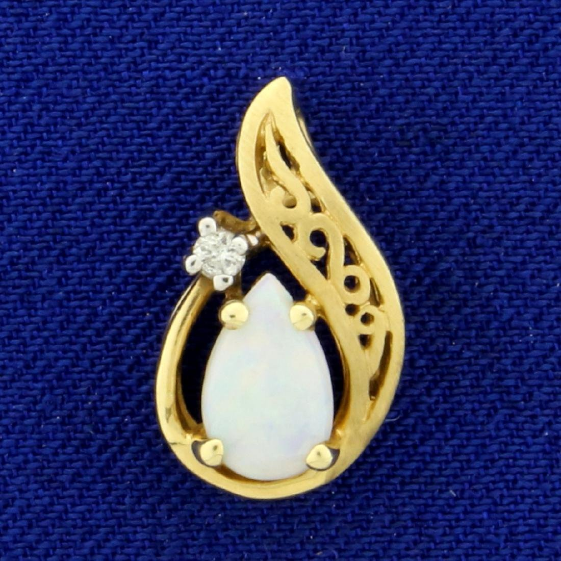 Pear Shaped Opal and Diamond Pendant in 14K Yellow Gold