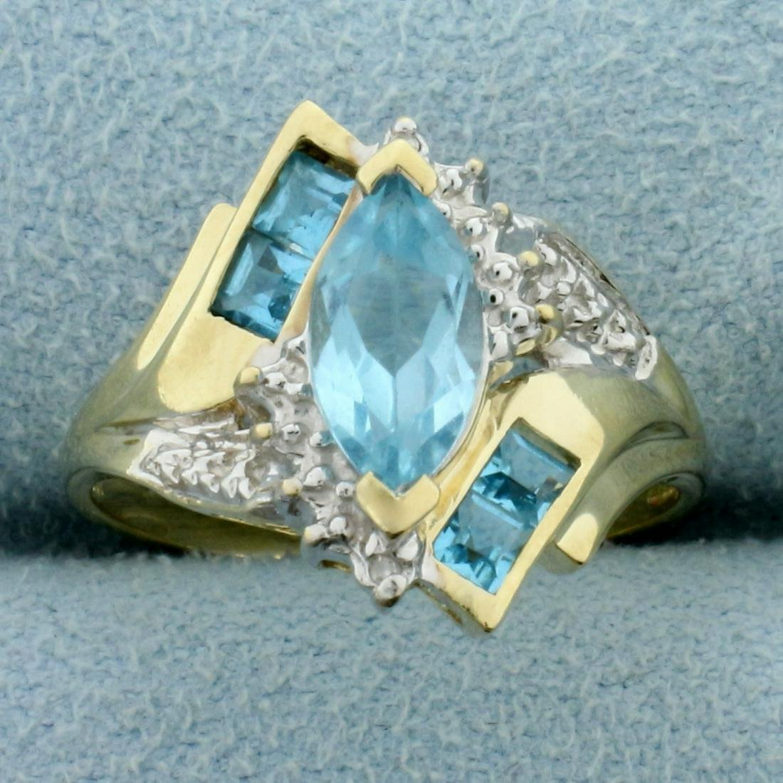 Sky Blue Topaz Bypass Ring in 10K Yellow Gold