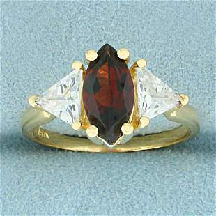 Garnet and CZ Three Stone Ring in 14K Yellow Gold