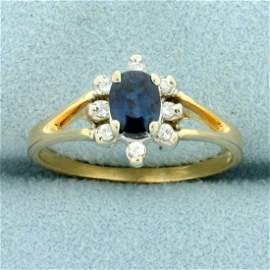 2/3ct TW Sapphire and Diamond Halo Ring in 14K Yellow