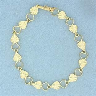 7 Inch Diamond Cut Heart Link Bracelet in 14K Yellow