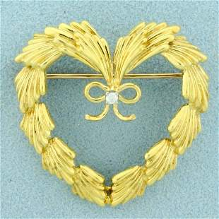 Authentic Cartier Diamond Heart Pin in 18K Yellow Gold