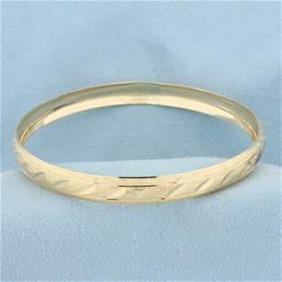 Diamond Cut Sparkle Bangle Bracelet in 10K Yellow Gold