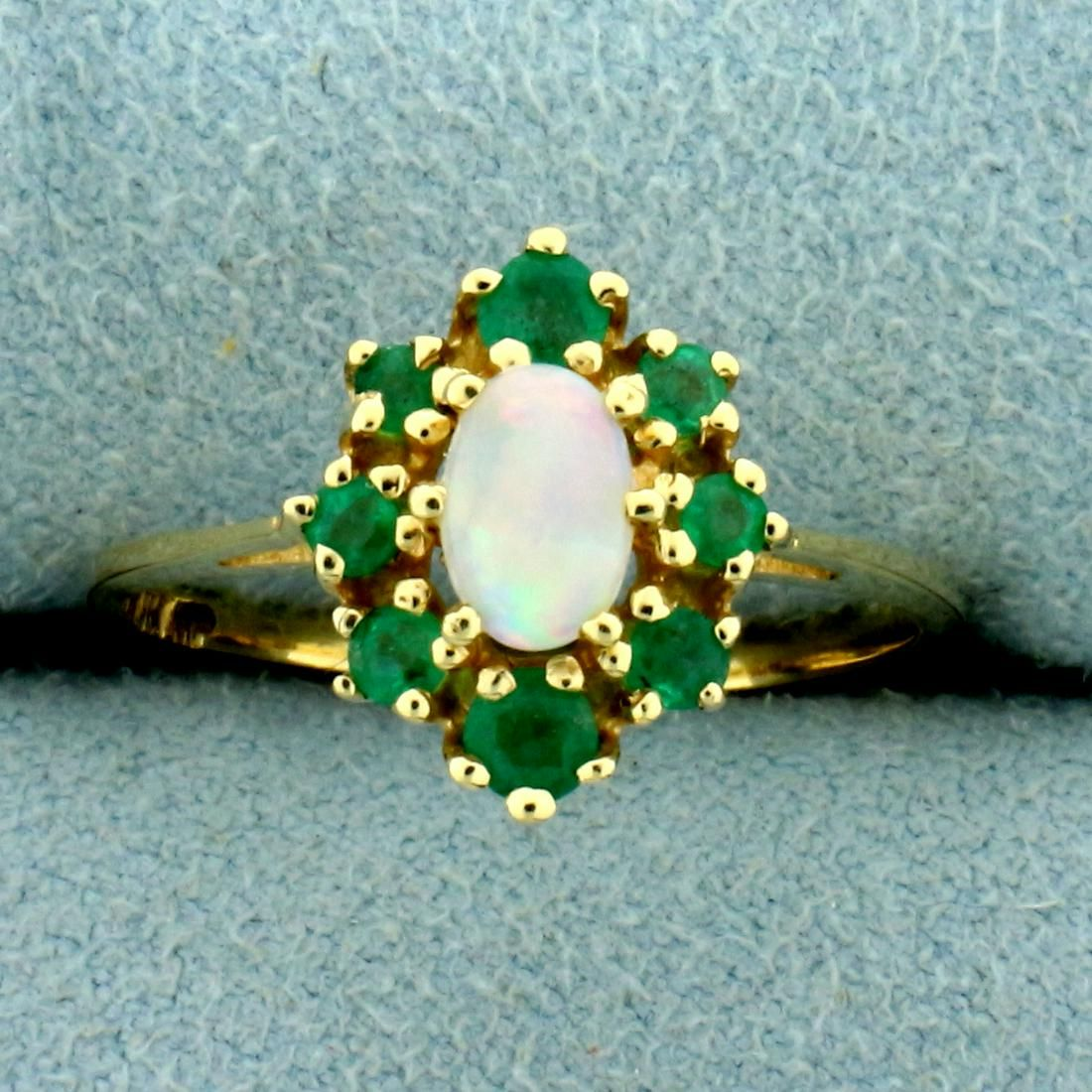 Opal and Emerald Halo Ring in 14K Yellow Gold