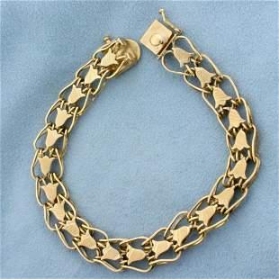 7 3/4 Inch Double Flower Design Bracelet in 14K Yellow