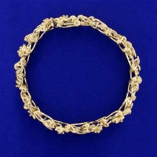 7 Inch Flower Design Bracelet in 14K Yellow Gold