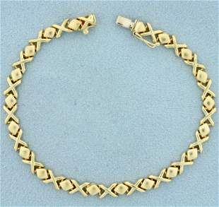 Italian Made X and O Design Bracelet in 14K Yellow Gold