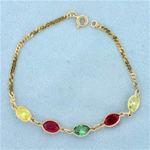 Multi-Colored Topaz Bracelet in 14K Yellow Gold