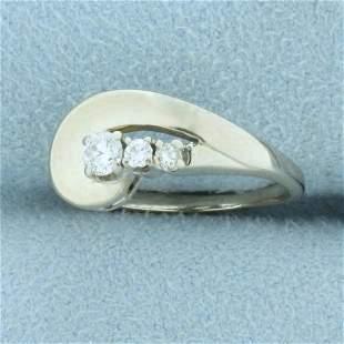 Modern Swoosh Design Three-Stone Diamond Ring in 14k