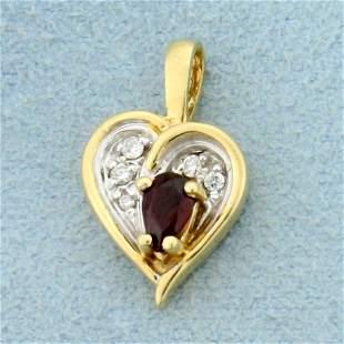 Garnet and Diamond Heart Pendant in 14K Yellow and