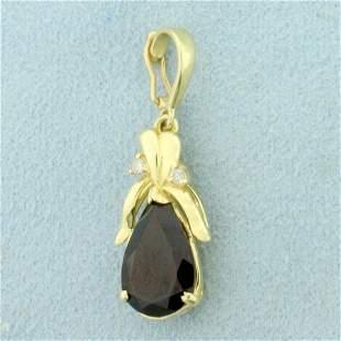 Garnet and Diamond Pendant in 14K Yellow Gold