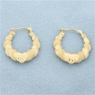 Diamond Cut Heart Hoop Earrings in 14K Yellow Gold