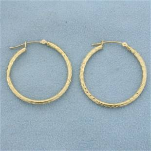 Diamond Cut Hoop Earrings in 14K Yellow Gold