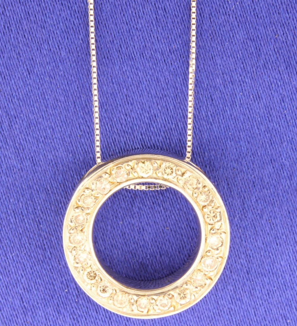 Diamond and 18k white gold circle pendant and chain