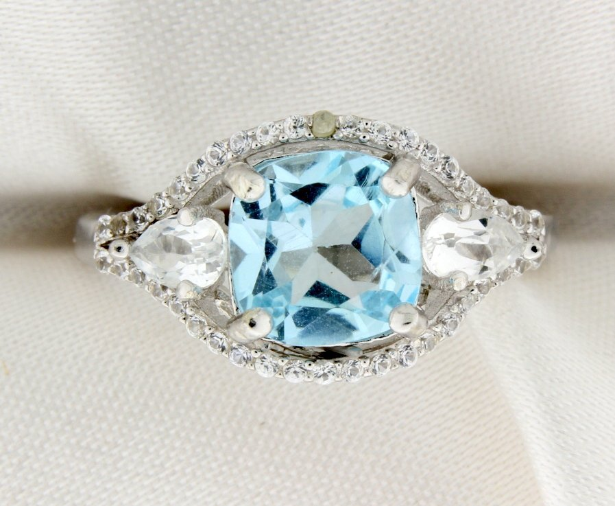 Blue Topaz and diamond sterling silver ring