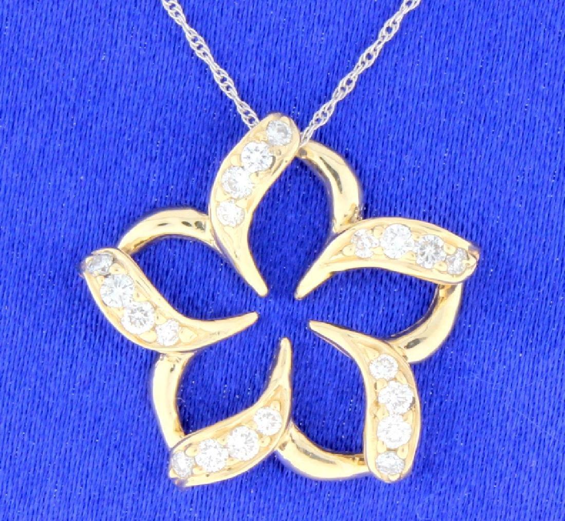 Diamond pinwheel flower pendant