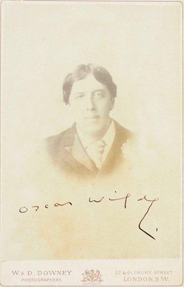 OSCAR WILDE. photographic portrait with signature
