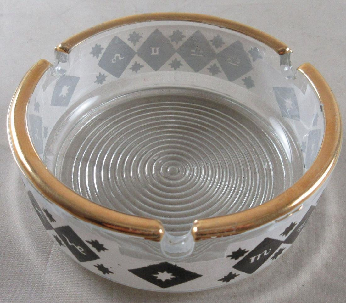 Vintage Ashtray with unknown symbols. Gold trim.