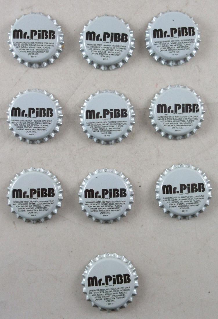 Vintage unused plastic lined Mr. Pibb soda caps. Coke