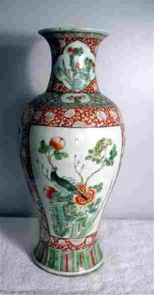 008: Overall brick vase with floral design and bird on