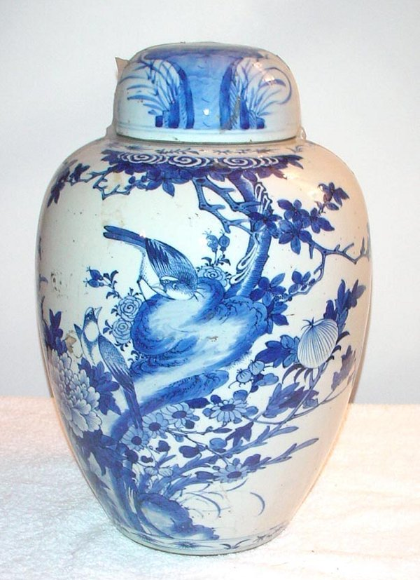 1005: Blue and White Elongated Ginger Jar with flowers