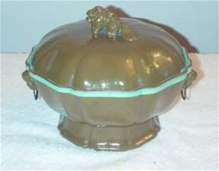 Teadust food warmer with Foo Dog knob on top of c