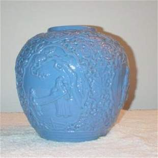 Blue Low Relief Jar with 4 panels with figures.