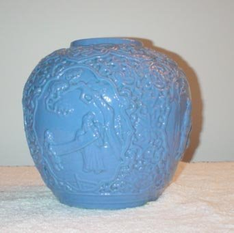 1020: Blue Low Relief Jar with 4 panels with figures.