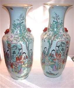 1040: Pair of white round vases with 3 figures and red