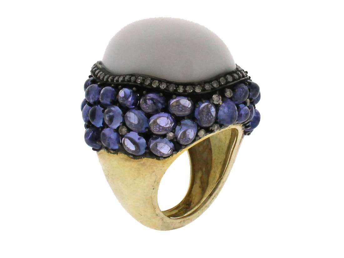 TANZANITE, ONYX AND DIAMOND RING